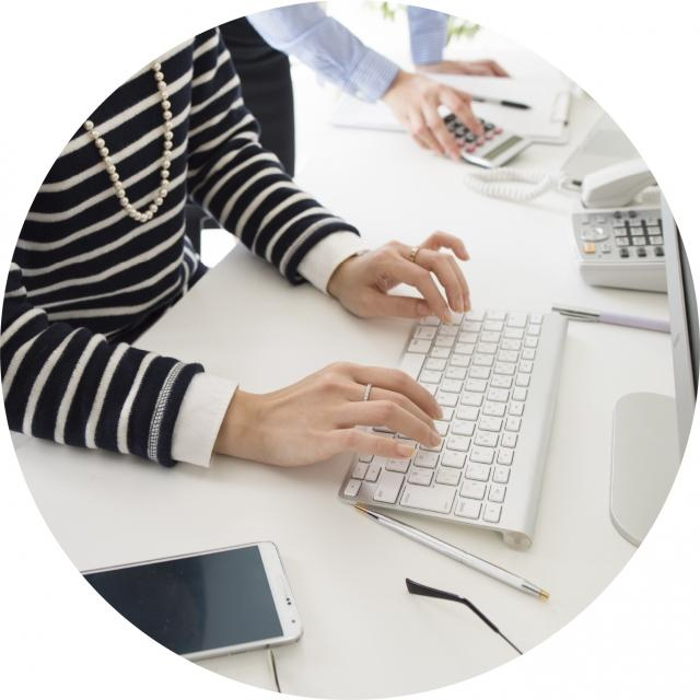 Woman typing Contract Management solutions