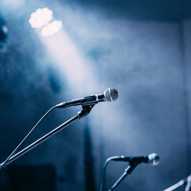 Microphones in the spotlight on a stage